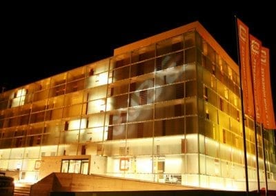 cube hotel orange illumiated facade night all-in-one sport