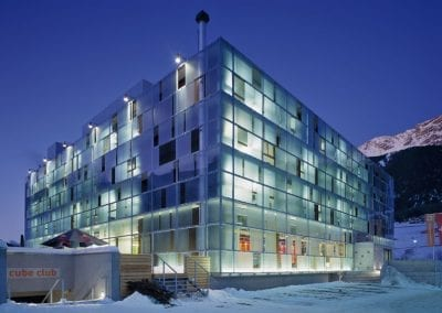 cube hotel savognin exterior view night winter