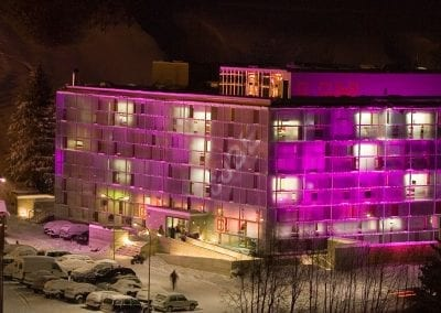 cube hotel savognin exterior view winter pink night