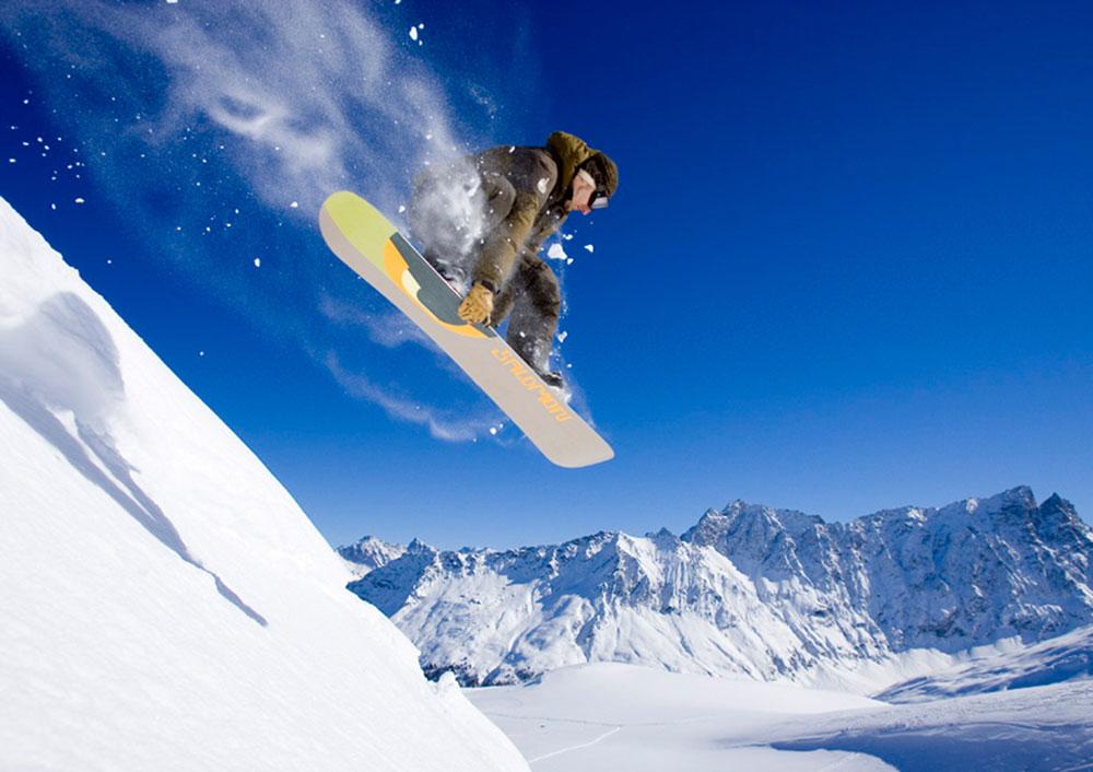 cube snowboarder powder jump